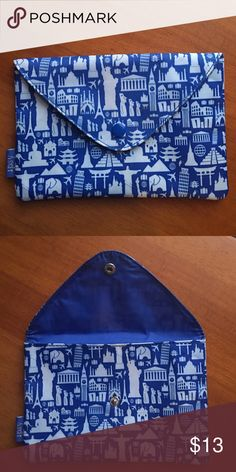 ipsy Blue Envelope Makeup Bag Blue & light blue ipsy Envelope Makeup Bag. Features landmarks of the world. Snap button closure. OFFERS ARE WELCOMED. 🙂 Sephora Accessories