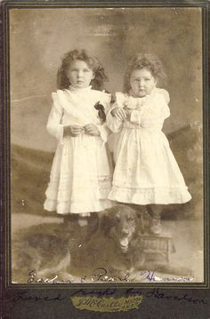 Cute curly haired sisters Esther and Pearl Hanson with the family dog. Cabinet Photo, Milton North Dakota Circa 1890s.
