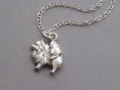 Pomeranian necklace, small silver dog pendant, silver plated chain, pet pooch jewelry (Ask a Question) $12.00 USD