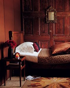 Red Brown  Red browns have a warm, rosy glow. Salvaged doors inspired this Vermeer-like setting: Fabrics were selected for reddish tones that complement the wood. Texture and luster are important here, too: Daylight brings out the sheen of the velvet comforter and satin pillow, lending life to the room.