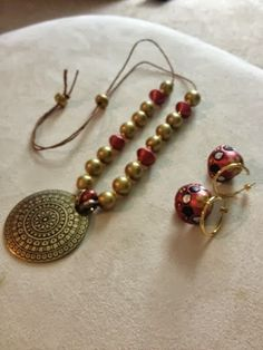 Brass pendant with clay beads - paired with the hoop jhumkis. Terracotta jewellery