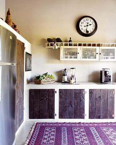 maybe we could do kitchen cabinets like this in our morton building home. Cheap if done with recycled wood. Add cement countertops and it would make a statement as well :)