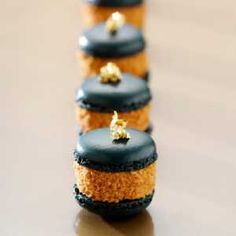 black macaroon with foie gras and gold leaf