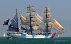 United States Coast Guard Cutter - Barque Eagle in Full Sail with American Flag Sailing in to San Francisco Bay California