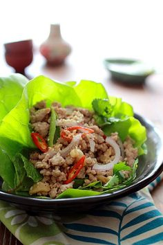 Larb Moo - minced pork tossed with scallions, lemongrass, chilies, cilantro, mint, and crushed uncooked rice.
