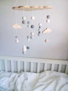 A beautiful collaboration between Felt That and Decor Handled.A cloud shaped ply … A beautiful collaboration between Felt that and Decor Handled.A cloud shaped ply header plate with cascades of gorgeous soft felt balls, crochet balls and baby clouds. Baby Bedroom, Nursery Room, Kids Bedroom, Nursery Decor, Cloud Mobile, Mobile Baby, Mobile Kids, Pom Pom Mobile, Felt Mobile