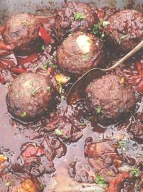 Jamie Oliver's monster meatballs: they're stuffed with cheese and smothered in a rich chilli sauce.
