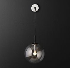 RH Modern's Languedoc Sconce:The character of 1960s French lighting is captured in this sconce from renowned designer Jonathan Browning. With glass globes suspended from a slender brass frame, the fixture has the appearance of magically floating in space.