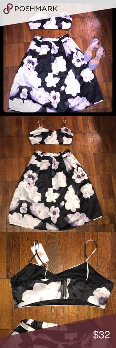 Floral Skirt Set Black and white floral skirt set with a hint of purple. The bralette has never been worn bc it did not fit me. Brand new with tags. The skirt was worn once. Great condition. Both pieces zip up in the back. The skirt also has pockets. Lulu's Skirts Skirt Sets