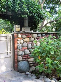 Love this river stone and brick wall