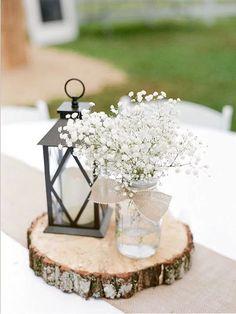 Rustic tree slice wedding centerpiece