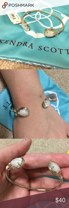Kendra Scott bracelet Silver or white bracelet depending on lighting with 2 white jewels. Even though it's big on my hand you can adjust to make smaller, I just didn't to keep in brand new condition. Still has tag, receipt, bag, and care card. Kendra Scott Jewelry Bracelets