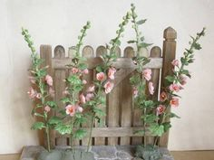 DIY Miniature   Fence with Flowers ~ I bet you can DIY this by using popsicle sticks and small fake flowers!