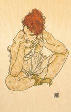 Mujer pelirroja sentada
