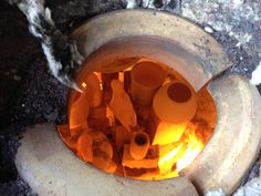 The view into a raku firing. The pots were removed and put into a burn bucket filled with newspaper. Sadly I dropped mine on the ground on the way to the bucket.