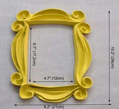 Perfect Gift for Your Friend Who LOVES Friends !! Who could forget Monicas iconic yellow peephole frame? Get one of your own to hang on your apartment door . Handmade. it is a beautifull reproduction made of special resin and hand painted. dimentions: 10,2 x 8,2 on the outside ---- 6,7 x 4,7 on the inside (see picture) dimentions in centimeters : 26cm x 21cm on the outside ---- 17,2cm x 12cm on the inside . The frame includes an imbedded sawtooth hanger. You can hang the frame easily…