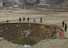 Sinkhole gawking in Hunan Province, China.  Fragile Earth Environmental photography series features global warming, climate change, eco-friendly and other environment issues.