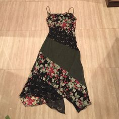 Flirty, spaghetti strap, mixed print dress This  flirty dress is excellent for the summertime! It's a mixed print dress with adjustable spaghetti straps! Almost brand new, only worn once, no damages. Express Dresses Asymmetrical