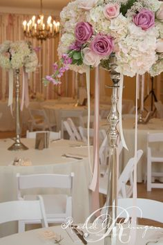 beautiful but I think these work better for round tables, or at the corners of a large U (if the rectangular tables are set up as a U  Wedding#tall# centerpiece#ribbon