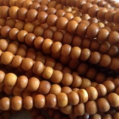 Wholesale sandalwood beads hand carved from Rajasthan, India.  Purchased in the holy city of Vrindavan, India.  These are premium sandalwood…