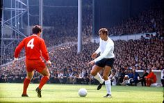 Martin Chivers of Tottenham Hotspur confronted by Liverpool's Tommy Smith.