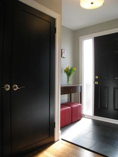 Paint on doors is in satin, by Benjamin Moore, colour is Jet Black. Walls are done in an eggshell finish. Colour of walls is Paper Clip by C2 Front Entry with Black Doors - traditional - Entry