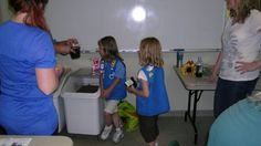 Girl Scouts planting flowers in recycled tire pots  www.flattireflowerpots.com