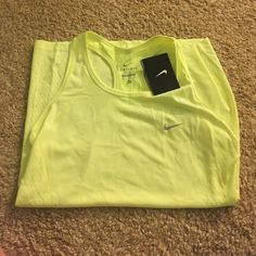 Brand new yellow Nike racer back work out tank As the title says! Bright yellow. Brand new with tags super soft material Dri Fit!! Nike Tops Tank Tops