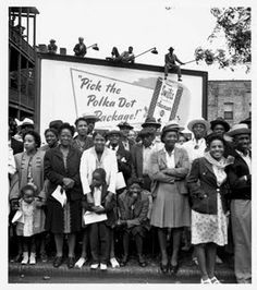 Spectators at the Bud Billiken Parade, which began in 1929 as the wish of Chicago Defender's founder Robert S. Abbott to organize the many youth who sold the newspaper. South Side, Chicago, 1946.    Photograph by Wayne Miller/Magnum.