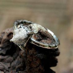 Sterling silver hand textured ring with by Sirilak Samansak of  Metal Studio Thailand.  http://metal-studio-thailand.com