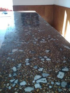 This is similar to what mine will look like. Polished Concrete Countertop with crushed marble. :)