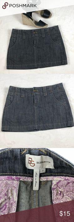 BCBG Dark wash denim skirt size 27 Pre loved BCBG denim skirt in EUC. It's a mini. Moon crest pockets in front. Super cute! BCBGeneration Skirts Mini