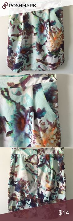 """Weston Wear abstract floral skirt Embossed cotton pleated skirt with abstract floral print. Lined w/navy cotton. Pockets on front and back zip. Waist measures 16"""" lying flat, 20.5"""" long. Size Large. Weston Wear Skirts"""