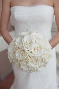 Gallery  Inspiration   Picture - 569963 plain white rose bouquet for the bride, maybe colors for bridesmaids so bride is only one with white