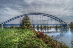 Bridge over Danubia in Bavaria by Helmut Schneller