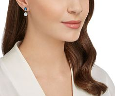 Two in one! This chic, modern pair of pierced earrings has a galactic feel with its spheres in palladium-plated metal and blue crystal pavé. Wear...…