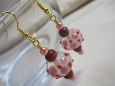Red and pink sputnik earrings. Wire wrapped by ArtsParadis on Etsy