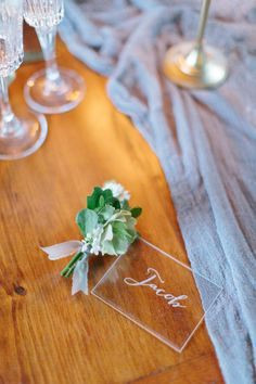 Clear etched escort cards: http://www.stylemepretty.com/little-black-book-blog/2016/03/28/dove-gray-soft-white-wedding-inspiration/   Photography: Megan Braemore - http://www.meganbraemore.com/