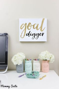 I love this gorgeous, feminine office space. That mason jar organization is perfect,