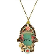 Delicate Hamsa medallion decorated with Jewish letters