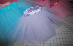 I like to make little kid tutus, and thought I would share my method for making them. Ordinarily I wouldn't bother, because it's just a dumb tutu, right? Well, no. It's a smart tutu. I looked around the web and found hundreds of tutu tutorials, but no one was making them like…