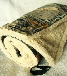 Realtree camo baby blanket with cream sherpa...except only Mossy Oak camo is allowed. ;)