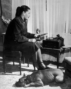 Billie Holiday listening to records with her dog Mister. Ca.1945