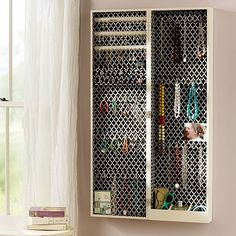 DREAM JEWELRY STORAGE ! Chloe Jewelry Storage Cabinet. I like the print on the back but find it too busy and distracting from the jewels I would hang in there.  I would add a swing out panel on the deep side with hooks on either side for more necklaces.  I have a ton of  necklaces!
