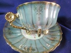 ROYAL SEALY TEA CUP AND SAUCER RARE FLOWER FEET & HANDLE TIEL LUSTER  GOLD TRIM