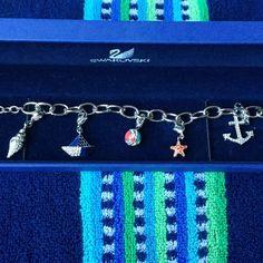 Swarovski Jewelry - Swarovski Charmed Bracelet with Beach Charms!