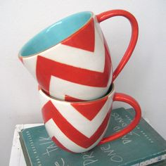 """So this is """"Buckley Chevron Mug in Coral by jillrosenwald on Etsy"""". But, I know there is a very similar mug at Caribou Coffee right now. I think the only difference is the color scheme."""