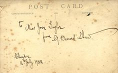 SHAW GEORGE BERNARD: (1856-1950) Irish Playwright, Nobel Prize winner for Literature, 1925. Vintage signed and inscribed postcard photograph, the image depicting Shaw standing in a half length pose with his arms folded. Signed in dark fountain pen ink to the verso, 'To Miss Joan Taylor from G. Bernard Shaw', and dated Clevedon, 16th July 1922, in his hand.