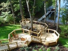 The perfect lakeside deck, this multi-level wood deck breaks up the steep descent to the water