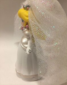 Mario is in a tux, Peach is in a wedding dress. These wedding themed Amiibos are great gifts for those getting married, who are already married, or who love collecting Mario and Peach figurines. They will make cute cake toppers as well! If you would like a wedding date painted on please send me a message with the date and where you would like it painted.  These hand painted Amiibos are unused in game. Each Amiibo comes in their own handmade satin drawstring bag inside the Amiibo packaging…